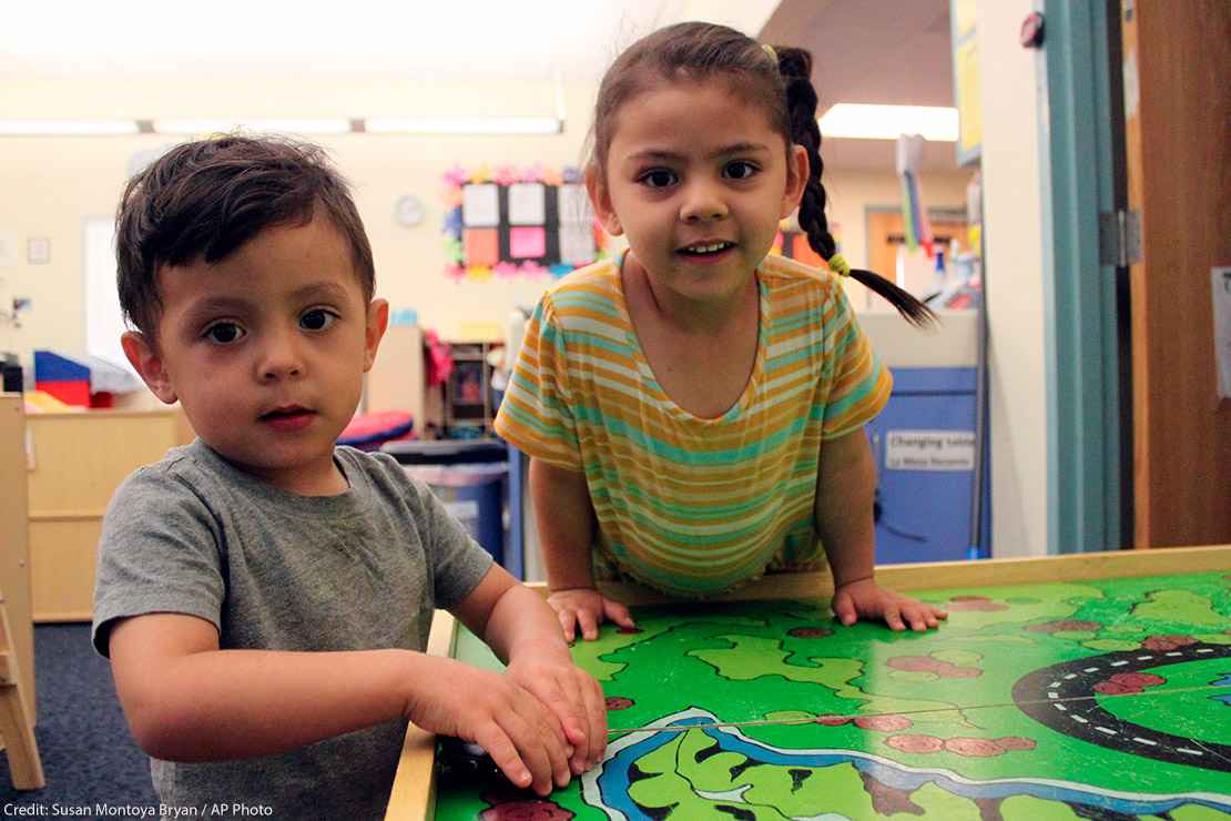 A young boy and girl play with their toy cars to wrap up the day at a day care Albuquerque, New Mexico