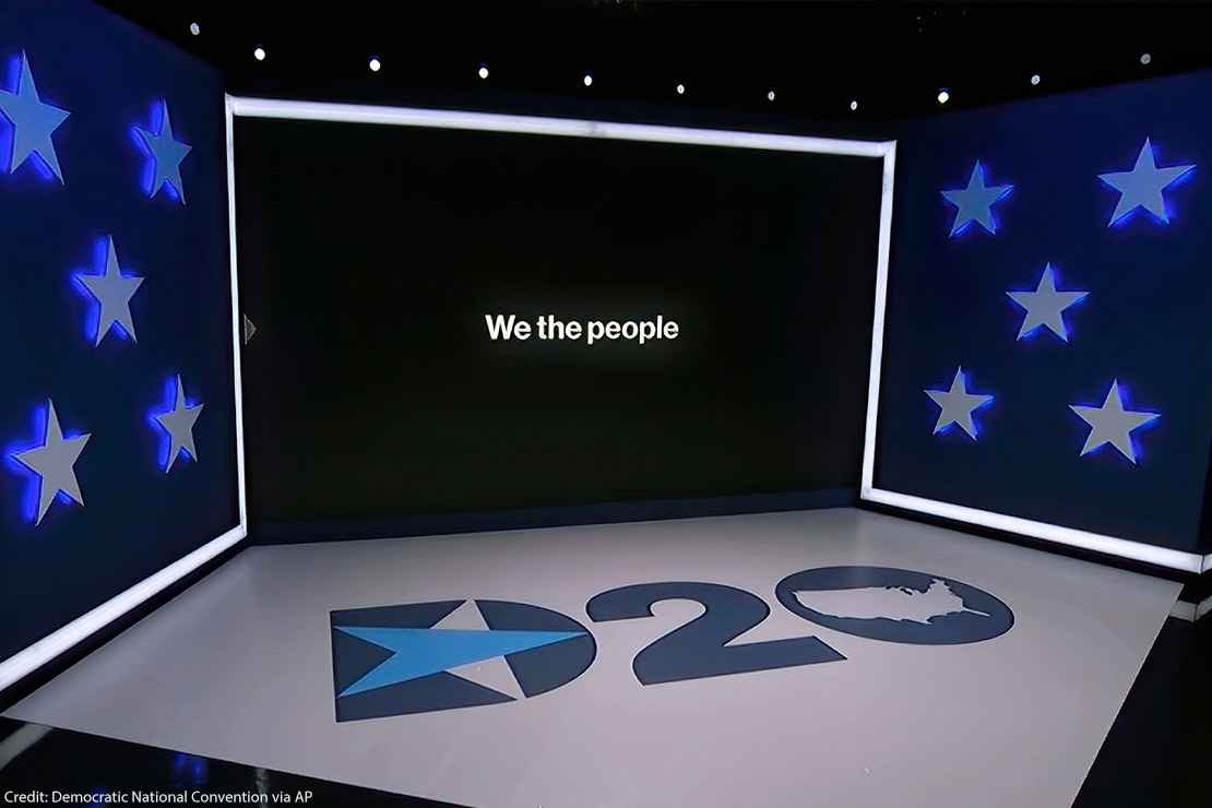 """The set in Los Angeles during the first night of the Democratic National Convention. """"We the People"""" can be read on the monitor."""