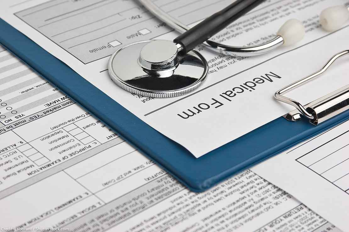 Clipboard with medical form and stethoscope attached