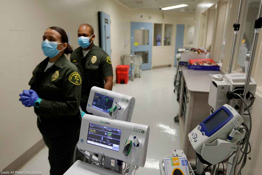 Custody assistants walking through hallway of the hospital ward in a jail in Los Angeles.